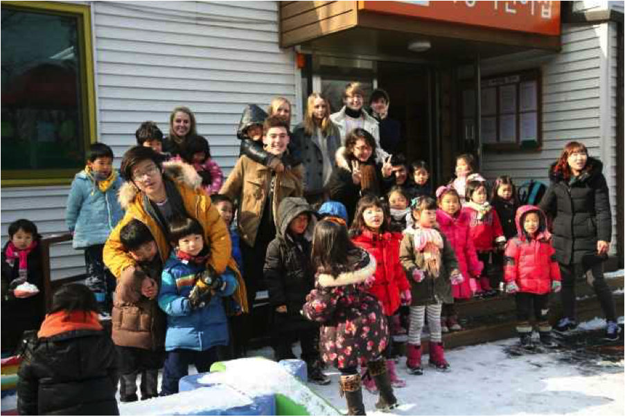 NSLI-Y students and kindergartens in front of the school.