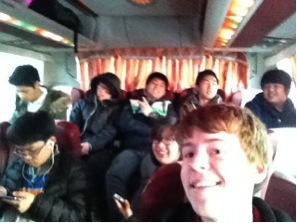 Jonathan and classmates posing inside a bus on their way to Busan.