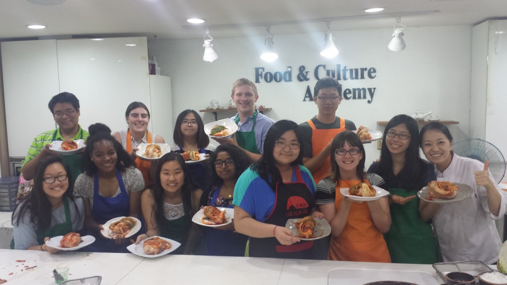 NSLIY Korea students in cooking class holding plates of kimchi!