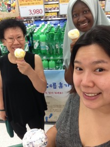 Bilqees and Host Family eating ice cream at a supermarket.