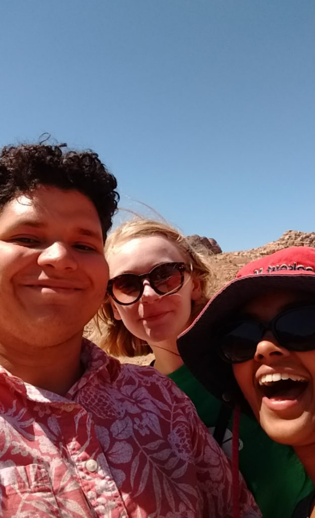 Picture of Omar with two friends in Jordan.