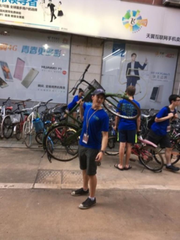 Students help straighten bikes on campus