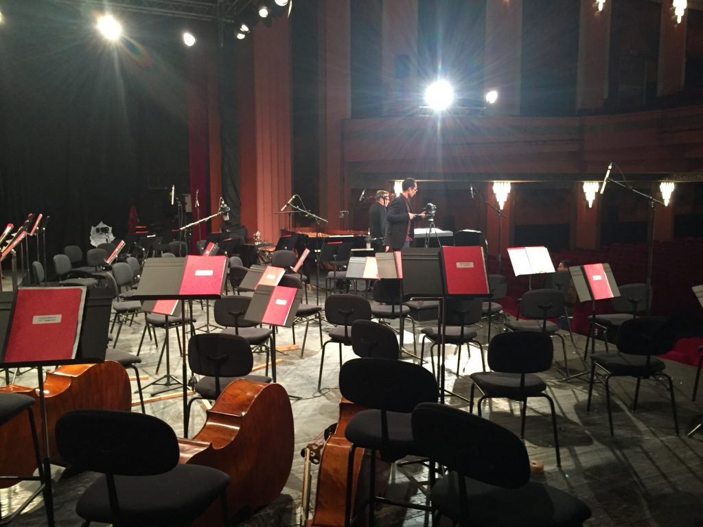 Picture of orchestra section before anyone sat down