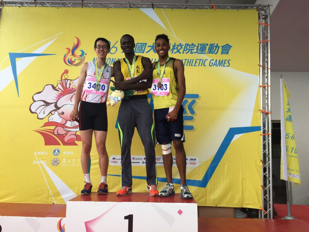 Joey standing along with the other two track stars who placed top three.