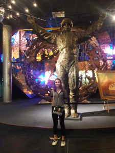 Lorae pictured in front of bronze astronaut in Museum of Moscow City.