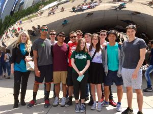 Devon takes a group picture in front of the Cloud Gate.