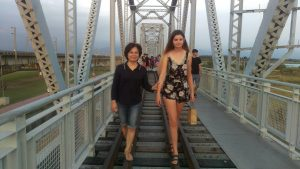 Heather and her host mom crossing a bridge.