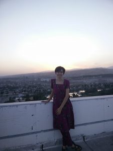 Mira posing in front of a Tajiki sunset.