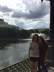 Chloe pictured with her friend in front of a beautiful river.