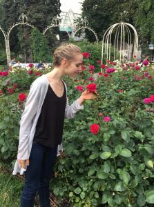 Rebekah posing with pink flowers.