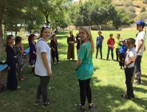 NSLI-Y Persian (Tajiki) participants Julia and Jessica playing with Camp America campers.