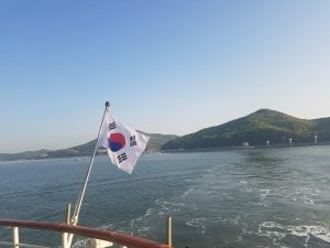 Korean flag hanging over water.