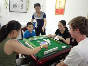 Picture of Andrew and his host family playing mah jong.