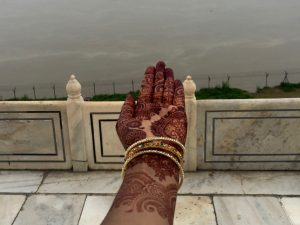 Roshni showing intricate henna on her hand