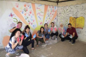 NSLI-Y students painting a mural