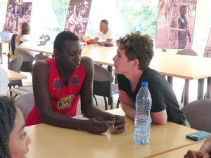 Skijler converses with a recent migrant to Morocco