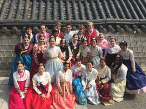 Group picture of everyone wearing Korean traditional clothing