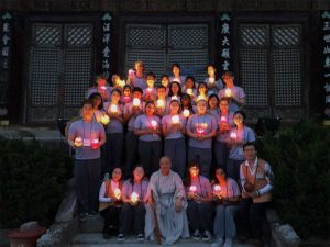 Group picture of everyone holding candles